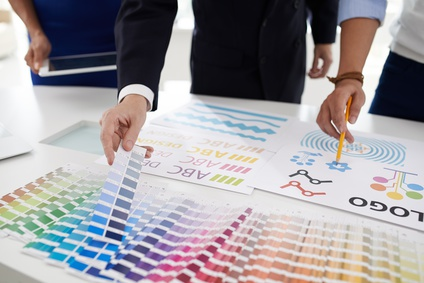 Design team choosing color palette for logo of the company